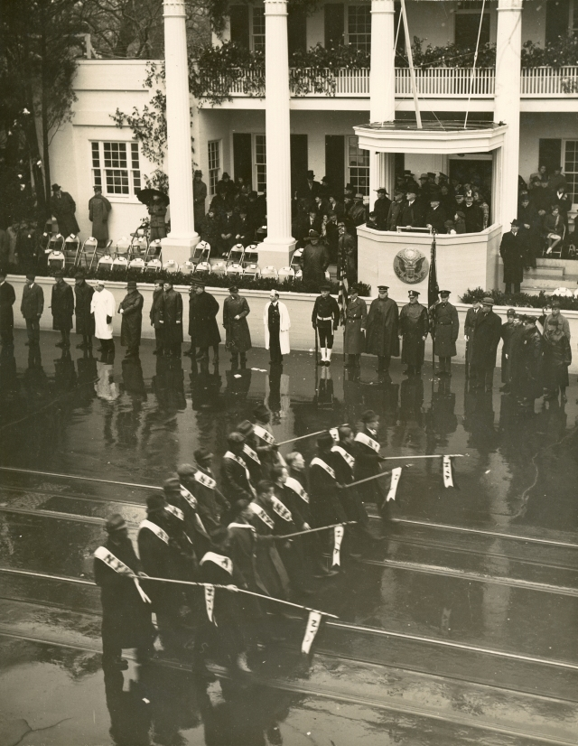 "President Roosevelt watching the Inaugural Parade from a replica of Andrew Jackson's ""Hermitage"" in front of the White House.  January 20, 1937."
